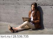 Купить «Young businesswoman sitting on floor looking at her laptop computer. Beautiful woman wearing formal wear using earphones.», фото № 28536735, снято 30 апреля 2017 г. (c) Ingram Publishing / Фотобанк Лори