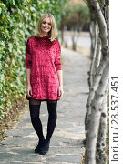 Купить «Beautiful blonde woman smiling in urban background. Young girl wearing red dress and tights standing in the street. Pretty female with straight hairstyle and blue eyes.», фото № 28537451, снято 22 января 2017 г. (c) Ingram Publishing / Фотобанк Лори