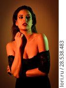 Купить «Young brunette woman in black lingerie with red and green lighting», фото № 28538483, снято 28 ноября 2017 г. (c) Ingram Publishing / Фотобанк Лори