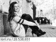 Купить «Portrait of funny female model of fashion with high heels sitting on the floor», фото № 28538651, снято 28 января 2015 г. (c) Ingram Publishing / Фотобанк Лори