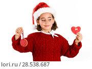 Купить «Adorable little girl wearing santa hat with Christmas cookies isolated on white background. Winter clothes», фото № 28538687, снято 6 ноября 2016 г. (c) Ingram Publishing / Фотобанк Лори