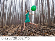 Купить «Beautiful blonde girl, dressed in green, jumping into the woods with a balloon in Fuente Vaqueros, Granada, Spain», фото № 28538715, снято 4 декабря 2011 г. (c) Ingram Publishing / Фотобанк Лори