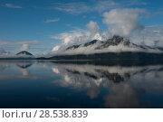 Купить «Reflection of mountain in water, Furry Creek, British Columbia, Canada», фото № 28538839, снято 22 марта 2016 г. (c) Ingram Publishing / Фотобанк Лори