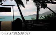 Купить «Seychelles, a cafe on the beach in the rain. 2013», видеоролик № 28539087, снято 4 июня 2018 г. (c) Mikhail Starodubov / Фотобанк Лори