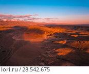 Купить «Red earth with iron oxides at sunset aerial view. Beautiful sunset. Martian landscape.», фото № 28542675, снято 25 сентября 2017 г. (c) Евгений Глазунов / Фотобанк Лори