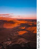 Купить «Red earth with iron oxides at sunset aerial view. Beautiful sunset. Martian landscape.», фото № 28542679, снято 25 сентября 2017 г. (c) Евгений Глазунов / Фотобанк Лори