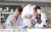 Купить «teacher and students studying chemistry at school», видеоролик № 28544243, снято 28 мая 2018 г. (c) Syda Productions / Фотобанк Лори