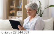 Купить «happy senior woman with tablet pc at home», видеоролик № 28544359, снято 30 мая 2018 г. (c) Syda Productions / Фотобанк Лори