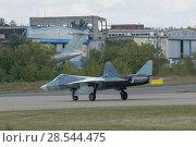 Купить «Новый российский многоцелевого истребителя пятого поколения Су-57( ПАК ФА, Т-50) на посадочной полосе, Международный авиационно-космический салон МАКС-2015», фото № 28544475, снято 23 августа 2015 г. (c) Малышев Андрей / Фотобанк Лори