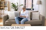 Купить «happy senior woman typing on laptop at home», видеоролик № 28544527, снято 29 мая 2018 г. (c) Syda Productions / Фотобанк Лори