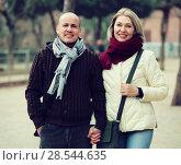 Купить «Couple relaxing during city walk», фото № 28544635, снято 18 октября 2018 г. (c) Яков Филимонов / Фотобанк Лори