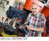 Professional shoemaker heeling footwear on machine. Стоковое фото, фотограф Яков Филимонов / Фотобанк Лори