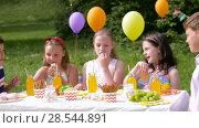 Купить «happy kids on birthday party at summer garden», видеоролик № 28544891, снято 5 июня 2018 г. (c) Syda Productions / Фотобанк Лори
