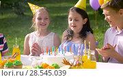Купить «happy kids on birthday party at summer garden», видеоролик № 28545039, снято 5 июня 2018 г. (c) Syda Productions / Фотобанк Лори