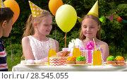 Купить «kids giving presents to birthday child at party», видеоролик № 28545055, снято 5 июня 2018 г. (c) Syda Productions / Фотобанк Лори