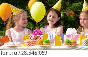 Купить «kids giving presents to birthday child at party», видеоролик № 28545059, снято 5 июня 2018 г. (c) Syda Productions / Фотобанк Лори