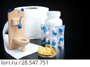 Купить «Wooden toy toilet, capsules and paper on black background», фото № 28547751, снято 24 мая 2018 г. (c) Papoyan Irina / Фотобанк Лори