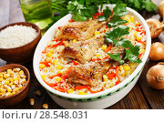 Купить «Chicken legs baked with rice and vegetables», фото № 28548031, снято 24 февраля 2018 г. (c) Надежда Мишкова / Фотобанк Лори