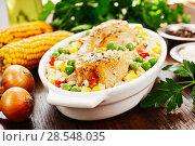Купить «Chicken legs baked with rice and vegetables», фото № 28548035, снято 6 марта 2018 г. (c) Надежда Мишкова / Фотобанк Лори