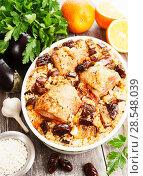 Купить «Chicken thigh baked with rice, eggplant and figs», фото № 28548039, снято 9 марта 2018 г. (c) Надежда Мишкова / Фотобанк Лори
