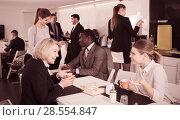 Купить «employees at a coffee break in the office», фото № 28554847, снято 10 марта 2018 г. (c) Яков Филимонов / Фотобанк Лори