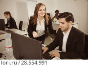 Купить «Young businesswoman flirting with Hispanic male colleague during», фото № 28554991, снято 24 марта 2018 г. (c) Яков Филимонов / Фотобанк Лори