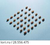 Купить «Figured pattern of almonds on a blue background», фото № 28556475, снято 3 мая 2018 г. (c) Ярослав Данильченко / Фотобанк Лори