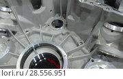 Купить «Cast aluminum transmission housing. The holes are machined on the CNC machine.», видеоролик № 28556951, снято 28 мая 2018 г. (c) Андрей Радченко / Фотобанк Лори