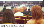 Купить «Many people sitting in the large hall at business conference», видеоролик № 28557223, снято 25 июня 2018 г. (c) Константин Шишкин / Фотобанк Лори