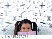 Купить «Composite image of schoolgirl covering mouth with book», фото № 28557771, снято 20 мая 2019 г. (c) Wavebreak Media / Фотобанк Лори