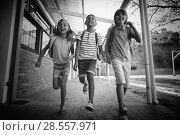 Купить «Happy school kids running in corridor», фото № 28557971, снято 20 мая 2019 г. (c) Wavebreak Media / Фотобанк Лори