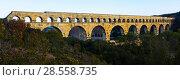 Купить «Pont du Gard, an ancient Roman bridge in southern France», фото № 28558735, снято 8 декабря 2017 г. (c) Яков Филимонов / Фотобанк Лори