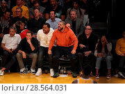 Купить «Celebrities at the Lakers game. The Los Angeles Lakers defeated the Golden State Warriors by the final score of 117-97 at Staples Center in downtown Los...», фото № 28564031, снято 4 ноября 2016 г. (c) age Fotostock / Фотобанк Лори