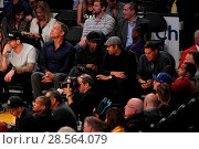 Купить «Celebrities at the Lakers game. The Los Angeles Lakers defeated the Golden State Warriors by the final score of 117-97 at Staples Center in downtown Los...», фото № 28564079, снято 4 ноября 2016 г. (c) age Fotostock / Фотобанк Лори