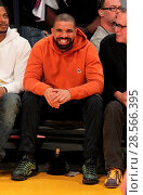 Купить «Drake sits court-side at the Los Angeles Lakers vs the Golden State Warriors game at the Staples Center Featuring: Drake Where: Los Angeles, California...», фото № 28566395, снято 4 ноября 2016 г. (c) age Fotostock / Фотобанк Лори