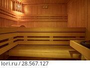 Купить «Sauna room interior», фото № 28567127, снято 23 сентября 2018 г. (c) Ольга Сапегина / Фотобанк Лори