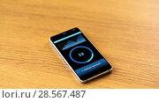 Купить «smartphone with cryptocurrency mining process», видеоролик № 28567487, снято 21 июня 2018 г. (c) Syda Productions / Фотобанк Лори