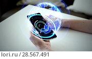 Купить «hands and smartphone with virtual earth hologram», видеоролик № 28567491, снято 22 мая 2019 г. (c) Syda Productions / Фотобанк Лори