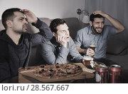 Купить «Males in suspense watching tv with beer and pizza», фото № 28567667, снято 10 января 2018 г. (c) Яков Филимонов / Фотобанк Лори