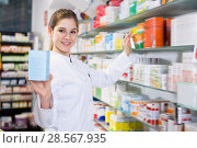 Купить «Ordinary female looking medicines near shelves», фото № 28567935, снято 28 февраля 2018 г. (c) Яков Филимонов / Фотобанк Лори
