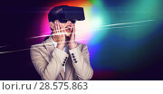 Купить «Surprised businesswoman wearing virtual video glasses», фото № 28575863, снято 10 июля 2020 г. (c) Wavebreak Media / Фотобанк Лори
