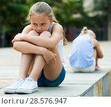 Купить «Small sisters upset after quarrel outside», фото № 28576947, снято 20 июля 2017 г. (c) Яков Филимонов / Фотобанк Лори