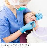 Купить «Girl getting dental treatment», фото № 28577267, снято 1 марта 2018 г. (c) Яков Филимонов / Фотобанк Лори