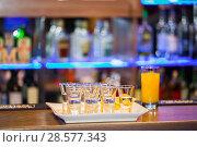 Купить «Alcohol shots on the bar», фото № 28577343, снято 14 декабря 2018 г. (c) Владимир Пойлов / Фотобанк Лори