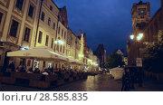 Купить «Cityscape of Torun with vibrant streets at spring twilight, Poland», видеоролик № 28585835, снято 11 мая 2018 г. (c) Яков Филимонов / Фотобанк Лори