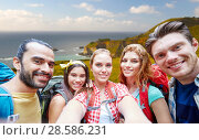 Купить «friends with backpack taking selfie over big sur», фото № 28586231, снято 25 июля 2015 г. (c) Syda Productions / Фотобанк Лори