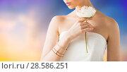 Купить «close up of beautiful woman with ring and bracelet», фото № 28586251, снято 9 апреля 2016 г. (c) Syda Productions / Фотобанк Лори