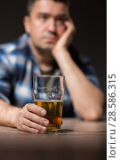 Купить «alcoholic drinking beer from glass at night», фото № 28586315, снято 24 ноября 2017 г. (c) Syda Productions / Фотобанк Лори