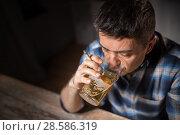 Купить «drunk man drinking alcohol and smoking cigarette», фото № 28586319, снято 24 ноября 2017 г. (c) Syda Productions / Фотобанк Лори