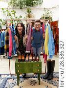 Купить «happy couple having fun at vintage clothing store», фото № 28586327, снято 30 ноября 2017 г. (c) Syda Productions / Фотобанк Лори
